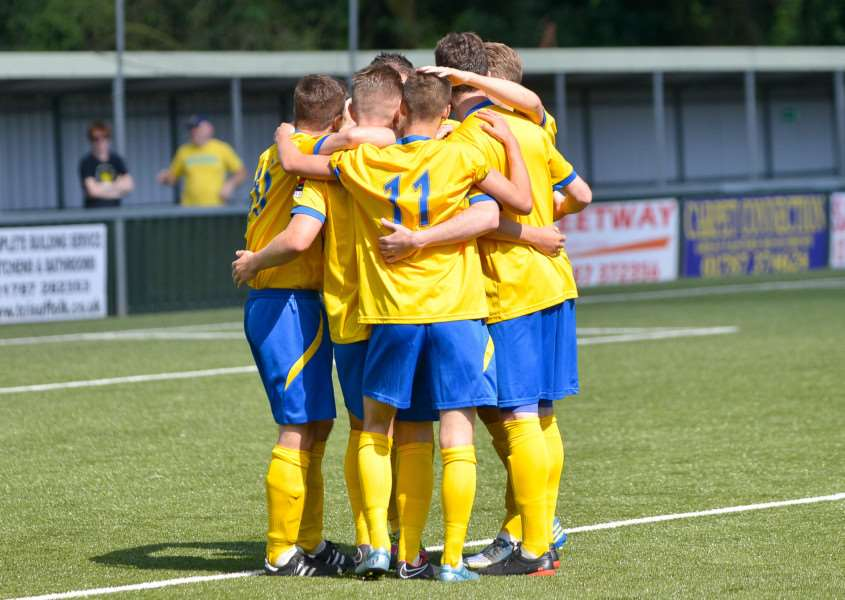 GUNNING FOR GLORY: AFC Sudbury players celebrate the opening goal against Romford on Saturday