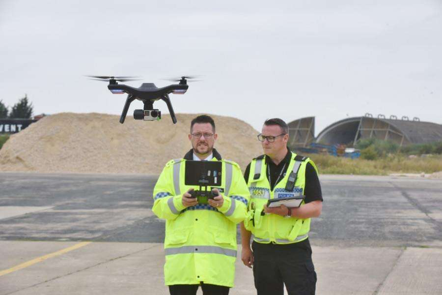 Cambs police with their new joint operations drone unit at RAFAlconbury. Drone pilots Inspector Chris Huggins (ful yellow jacket) and PC Liam Denman EMN-160709-160451009