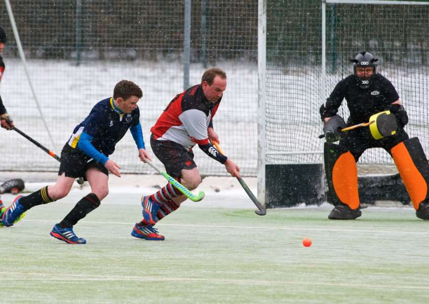 SNOWY SCENES: Sudbury Men's II's home game with UEA II was played out with snow falling but only went ahead after the lines were swept Picture: Mark Bullimore