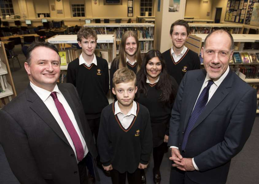 Lee Walker is the new headteacher at King Edward VI School, in Bury St Edmunds. He is pictured with outgoing head Geoff Barton and pupils. Picture by Mark Westley.