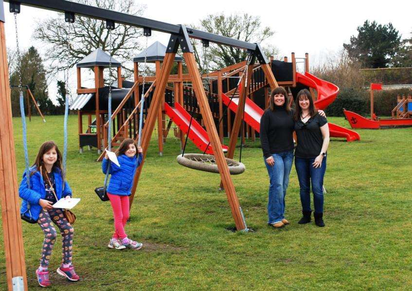 Suzy Clarke (left) and Isabel Mackay-Yau with a couple of village youngsters at the Ridgewell playing field.
