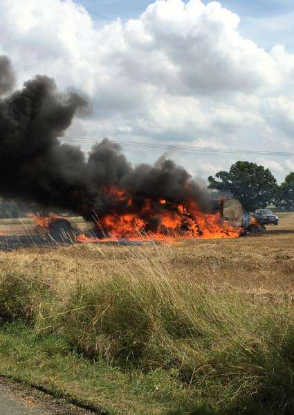 Firefighters extinguished a blaze which engulfed a tractor in a field in Langham. Picture courtesy of James Catton.