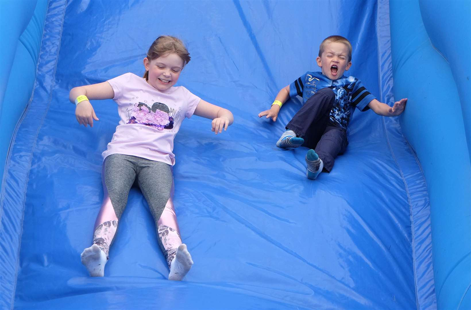 Sophie Dykes, 9 and Luca Dykes, 5 enjoy the family fun day at Acton Village Hall.Pic - Richard Marsham (2230444)