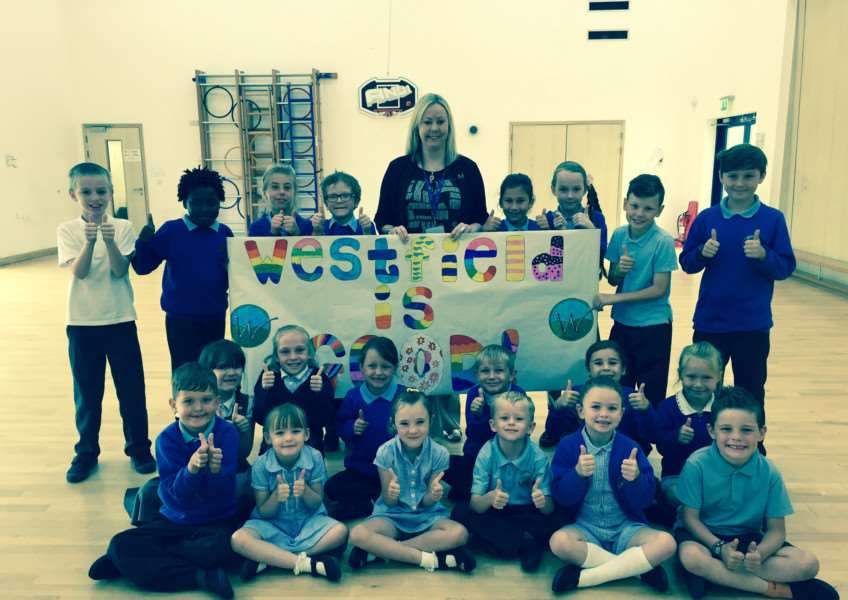Westfield Primary Academy pupils share the joy of its being rated a 'Good' school by Ofsted inspectors with head teacher Nicky Tyler ANL-150807-101835001