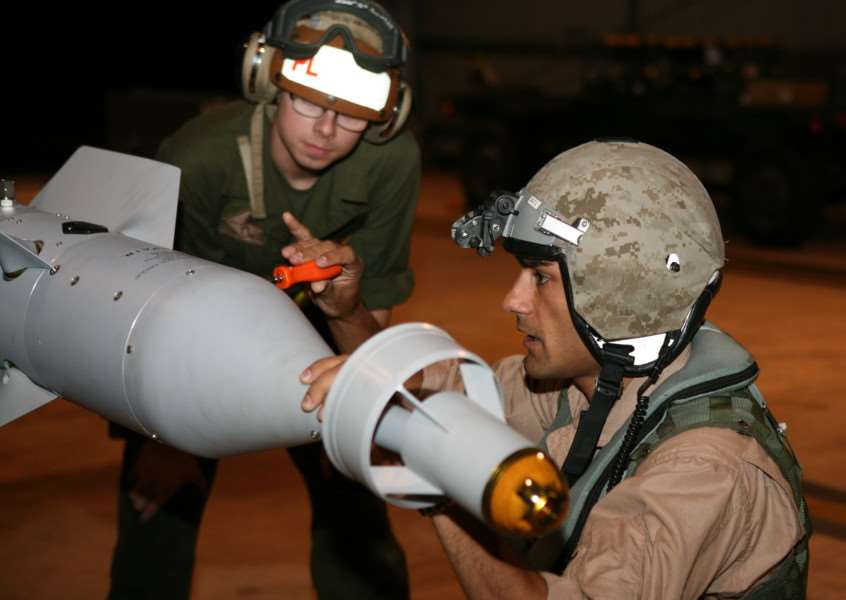 Then Captain Taj Sareen,in 2012 when he was also the squadron's quality assurance safety officer, conducting pre-flight checks to ordnance loaded before flight operations'Picture: USMC/Cpl Vanessa Jimenez