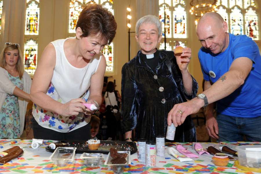 Lego launch at Bury cathedral ''Pictured: MP Jo Churchill and Dean of Cathedral decorating cakes ANL-160530-192809009