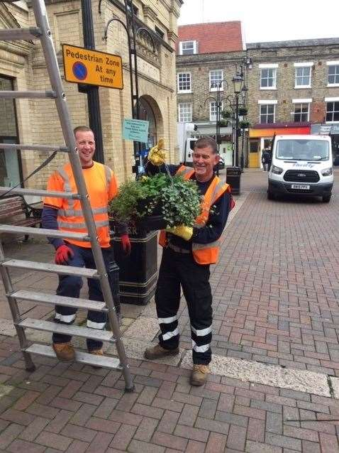 A West Suffolk Council team put up the winter hanging baskets