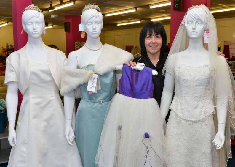 Volunteer at St Nicholas Hospice Care Shop in Mildenhall Mandy Cooke with just some of the donated wedding dresses, tiaras and shoes. ANL-150215-214815009