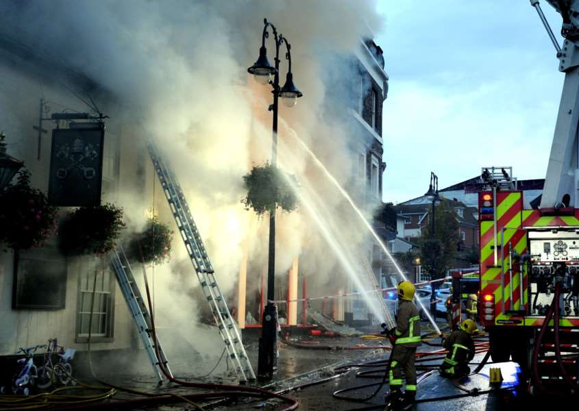 Firefighters tackle the serious fire at the Cycle King shop, on Angel Hill, in Bury St Edmunds. Picture: Andy Abbott.