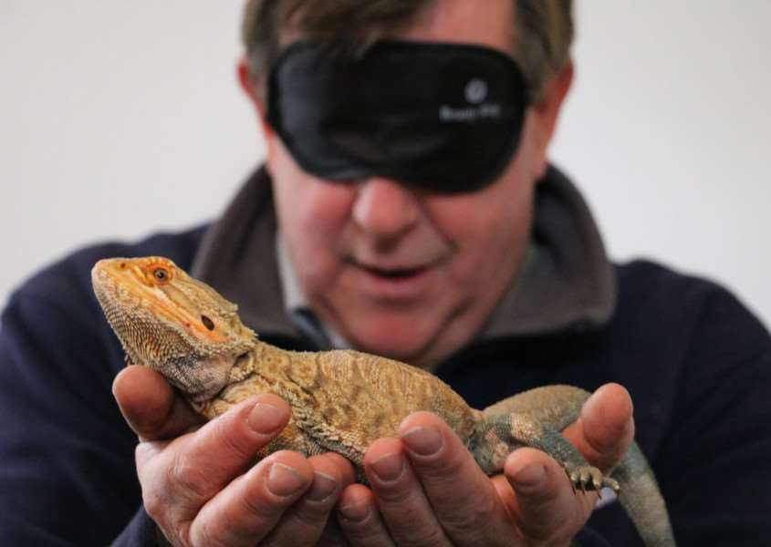 St Nicholas Hospice Care's Board of Trustees Chairman Charles Simpson meets an Australian bearded dragon ANL-161024-144736001