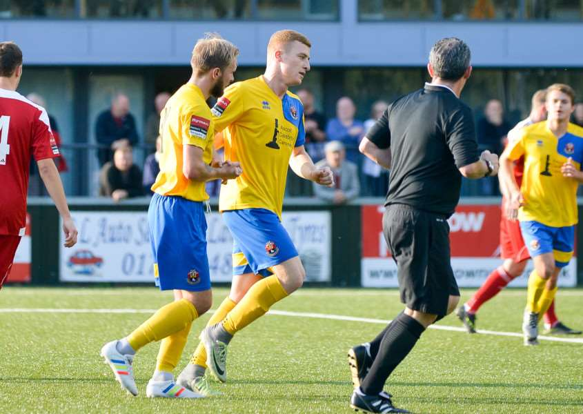 AFC Sudbury (yellow) v Bowers & Pitsea in the 1st Round Qualifying FA Trophy. Sudbury number 7 Sam Bantick celebrates his penalty. ANL-161030-110152009