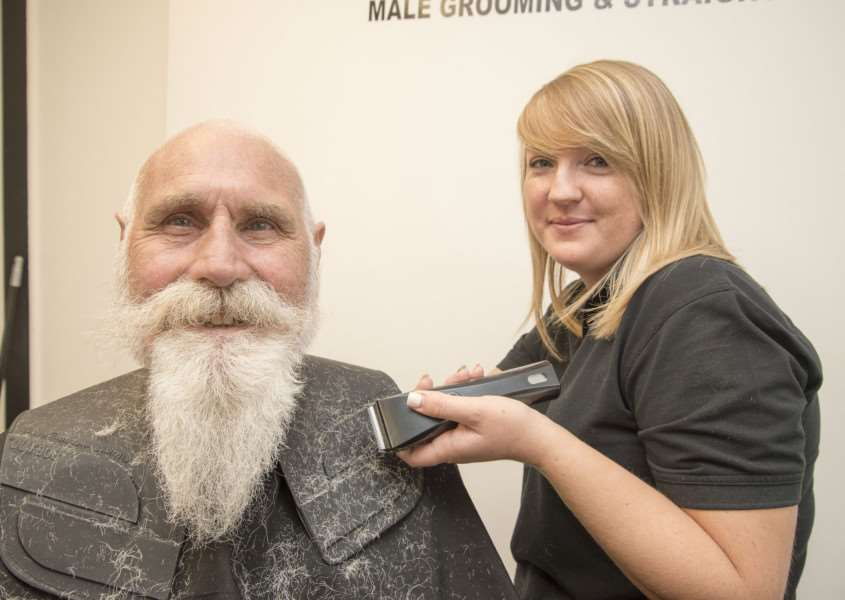 Charity hair and beard shave for Michael Howard at Medleys in North Street Sudbury, Odette Medley with the clippers helped by her brother and shop owner Sonny, 'Picture Mark Westley ANL-160830-170352009