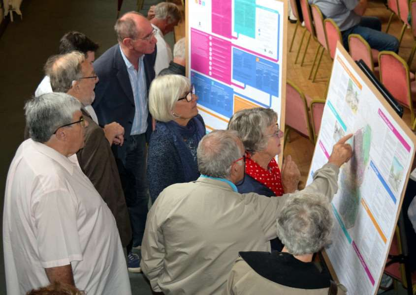 People viewing the draft plan at the Bury Society/Churchgate Area Association open meeting on Bury St Edmunds Town Centre Masterplan at The Athenaeum