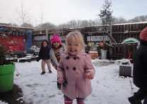 Children at Dizzy's Day Nursery play in the snow. Contributed picture