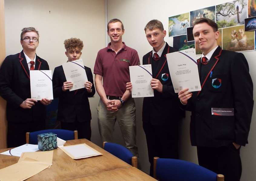 Year 10 students Kieran Hall, Kyron Shipp, Green Light Trust Team Leader Andrew Brooks, Sam Nunn and Dylan May receive their awards for successfully completing nationally recognised Practical Environmental Conservation Skills (PECS) Level 3.
