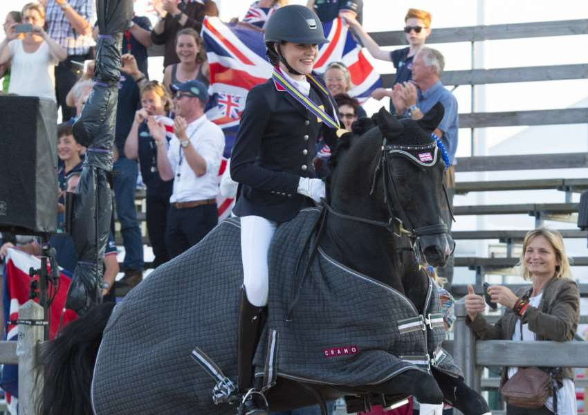 GOLDEN GIRL: Bury St Edmunds equestrian star Clare Hole, 13, and her pony Rembrandt