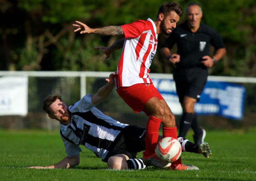 SLIDING CHALLENGE: Dan Swan tries to win the ball back for Melford