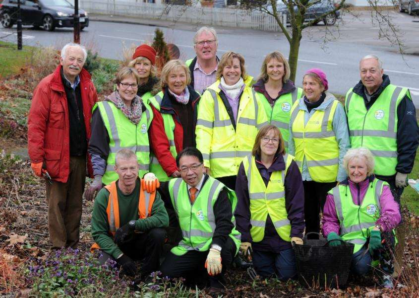 Adrian Bloom from Bressingham Gardens and Bury in Bloom volunteers were tidying up the River of Flowers on the Tollgate Triangle.'''Picture: Mecha Morton.