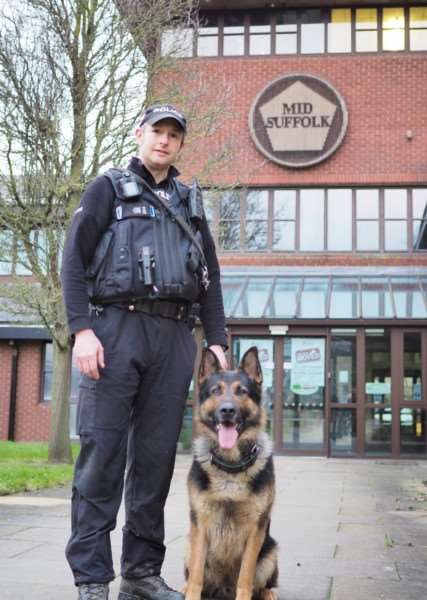 PC Simon Hughes with Ivan, a Suffolk Police German shepherd, outside the former Mid Suffolk District Council offices in Needham Market following a training session.