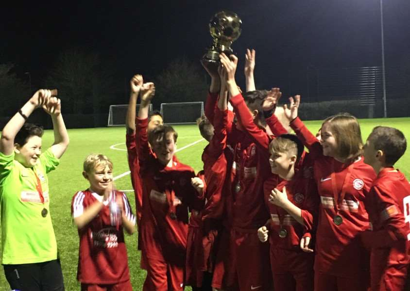 HAPPY DAYS: Haverhill Rovers Under-12s celebrate winning the D�j� vu Matchday Experience Cup