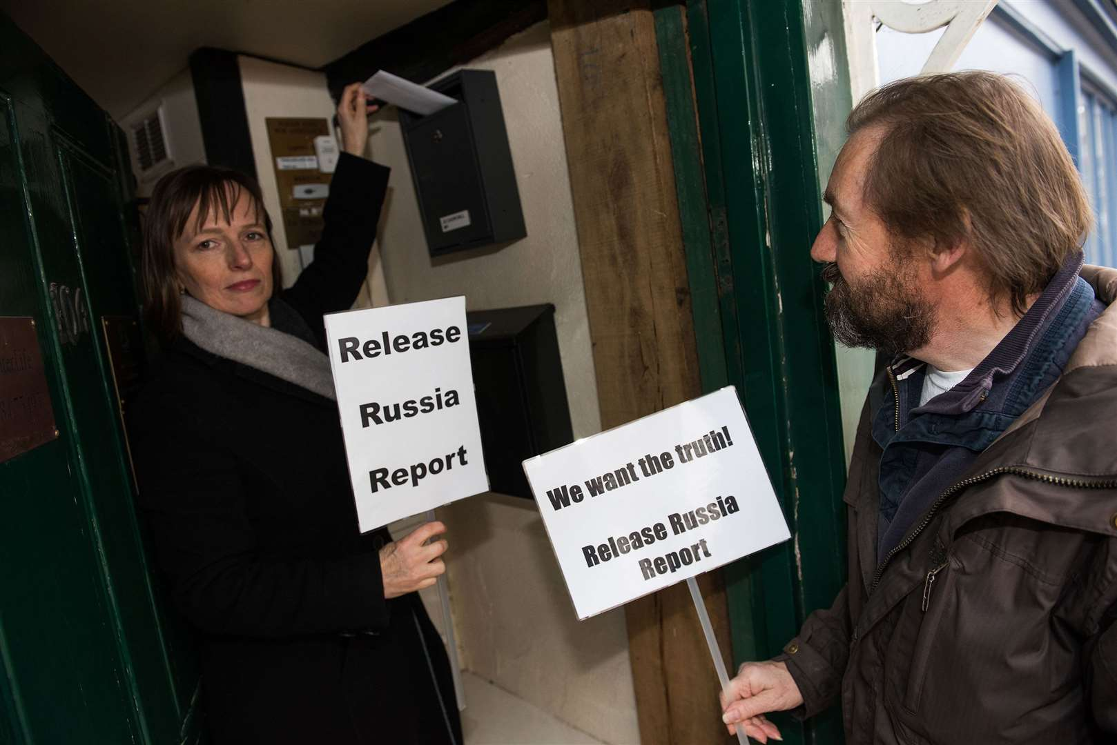 Christina Birt and Robert Duncan deliver the letter to Jo Churchill's office in campaign to end Russian interferance. Picture by Mark Westley.