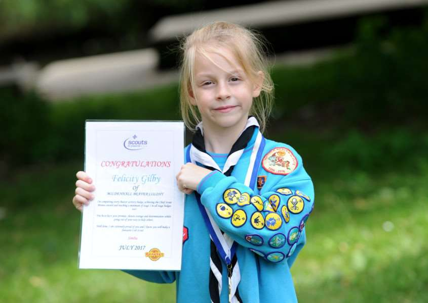 Seven-year- old Felicity Gilby, a Beaver member of the Mildenhall Scout Group, has earned all 20 activity badges, six challenge awards, eleven staged badges, has participated in 7 nights away, has been a lodge leader and has earned the prestigious Chief Scout's Bronze Award.''''PICTURE: Mecha Morton