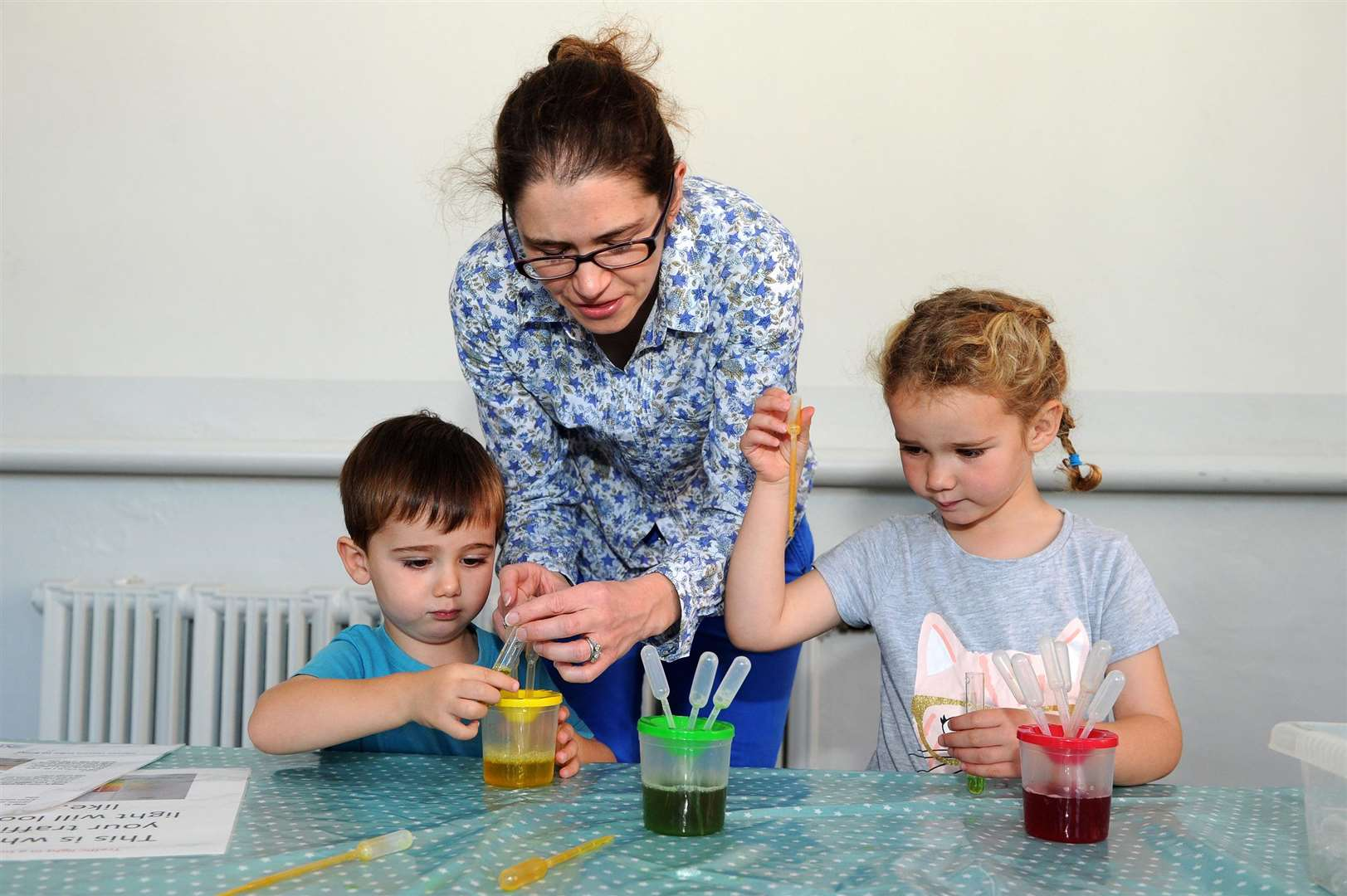 Mum Helen Heywood with Nathaniel, two, and Martha, five, making traffic lights.