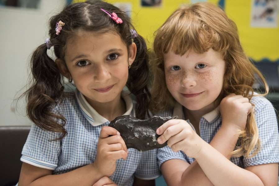 Chilton Community Primary School student 'Maria Eidell and Sophie Meadows hold a meteorite sample 'Picture Mark Westley