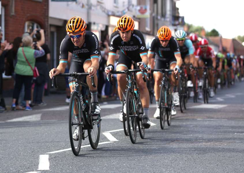 FLYING THROUGH: The peleton makes its way through Hadleigh town centre on Saturday, en-route to the finish line in Ipswich