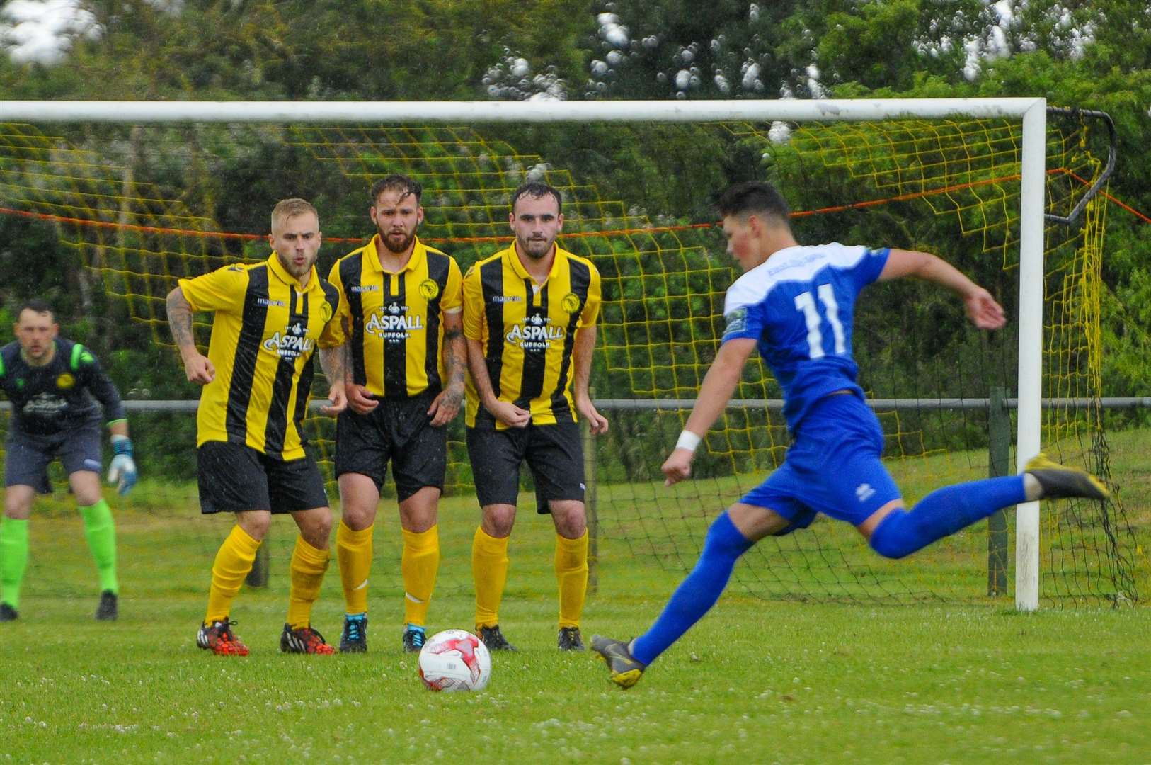 Trialist Ross Crane takes a free-kick for Bury Town at Debenham LC on SaturdayPicture: Mark Bullimore