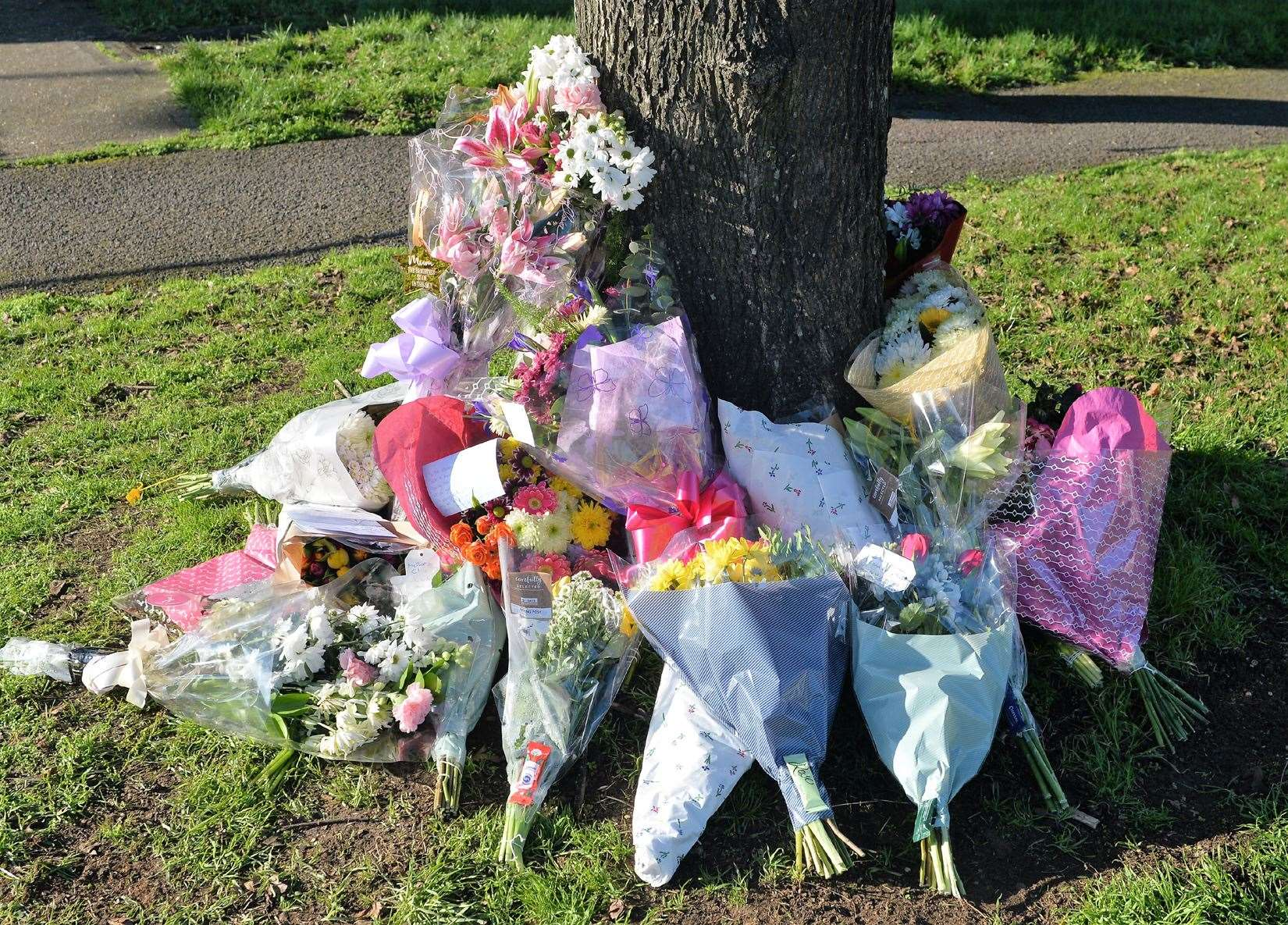 Floral tributes left for Clare Nash outside her home in Brickfields Avenue, Newmarket.