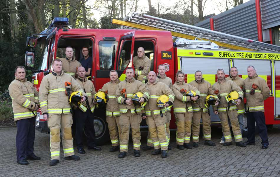 Firefighters from Bury St Edmunds pictured with the appliance that may be lost due to cut backs. ANL-151125-174543009