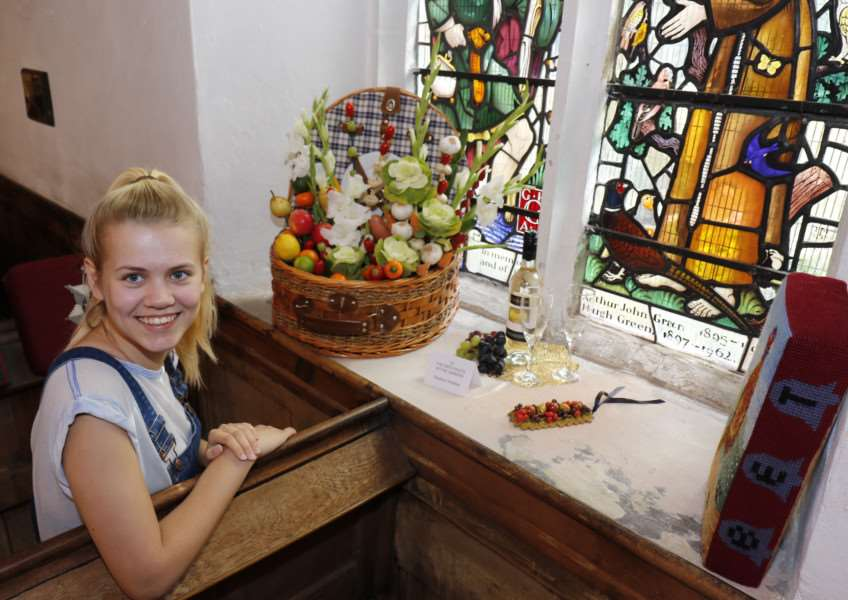 St Cuthbert's joins the Thetford Great Festival for the first time with All Things Bright and Beautiful flower festival. Pictured is Jodie-Louise Phillips, 19 with The ripe fruits of the garden by Pauline Christian.''Picture: MARK BULLIMORE ANL-160309-215009009