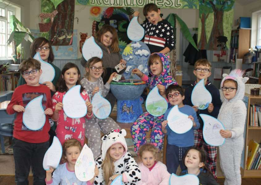 Children at the Creative Education Centre have been throwing money down the toilet to raise funds for the charity Toilet Twinning