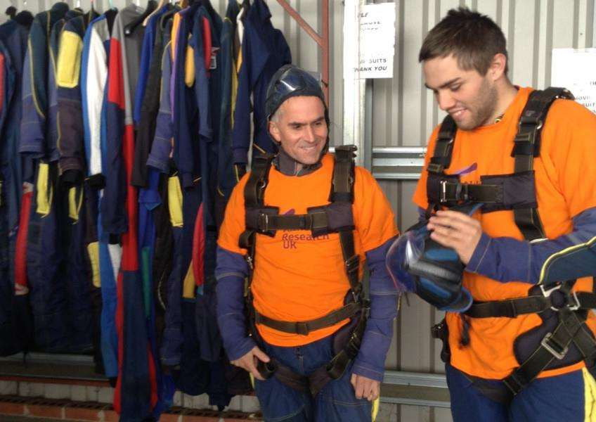 Danny (left) and Ross Bramhald get geared up for their charity skydive