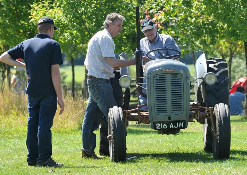 Enthusiasts gather round a classic Ferguson tractor