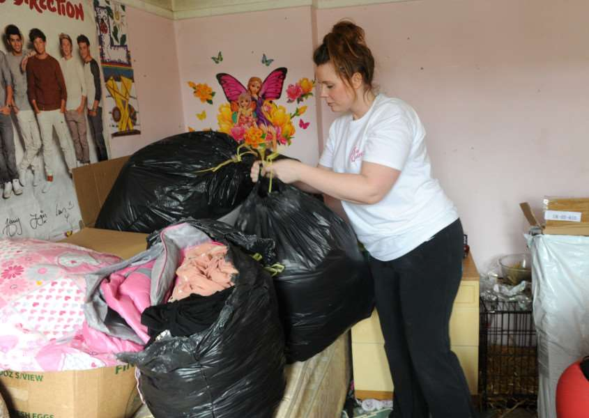Amy Garrod of Squeaky Queens gets some of the clutter sorted out to make the rooms more accessible for Jo and Lydia ANL-160221-183921009