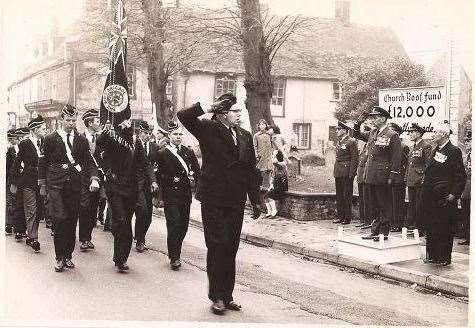 Eric Peel (front and centre) as he leads the annual remembrance day parade through Mildenhall.