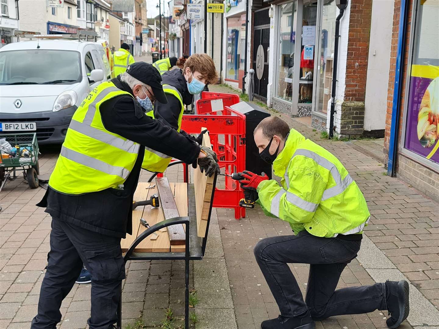 Steve Betteridge, Patrick Sneezum and Ben Prickett from Haverhill Town Council at work on a bench in Queen Street. Submitted picture