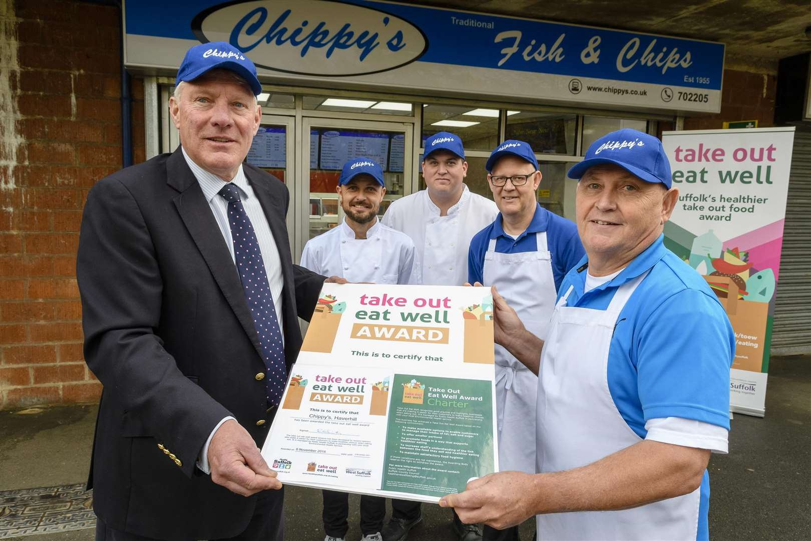 Cllr John Griffiths, Leader of St Edmundsbury Borough Council awarding the first Take Out Eat Well Awards in West Suffolk, which recognises takeaway food businesses that offer healthier food choices, to Glenn Edwards of Chippy's Fish and Chips in Strasbourg Square, Haverhill. With him are staff, from left; Lee Taylor, Barry Lumm and Christopher Edwards.