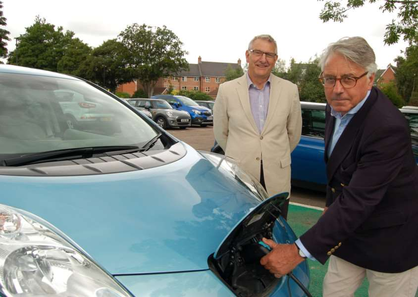 Live wire councillors David Bowman, left, and Peter Stevens plug in a Nissan Leaf electric car