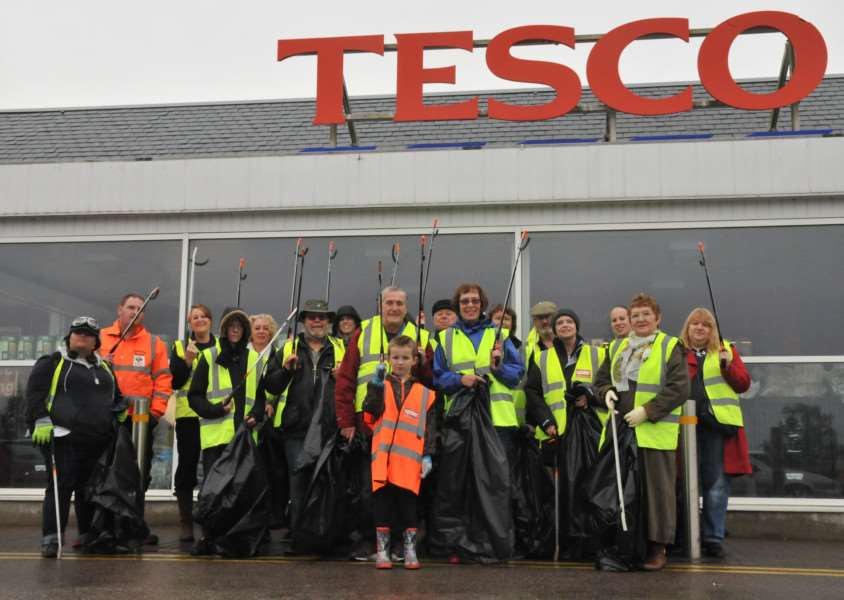 Despite the rain residents and councillors, both young and old, took to the streets around Tesco in Sudbury to clean up the area. ANL-150411-101900001