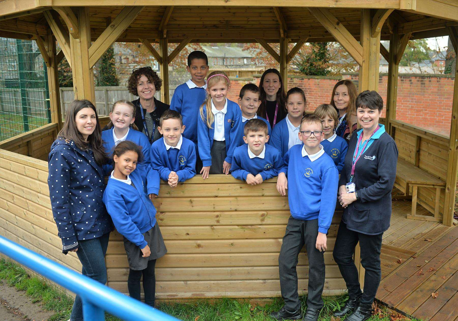 All Saints' Primary School pupils in their new outdoor-classroom with headteacher Jane Trampnow and Laura Wing and Caroline Donnelly from Anglian Water