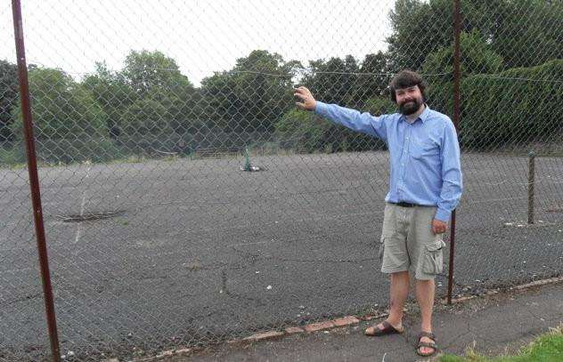 Dr Francis Young in front of the Abbey Gardens tennis courts in Bury, where he believes St Edmund is buried