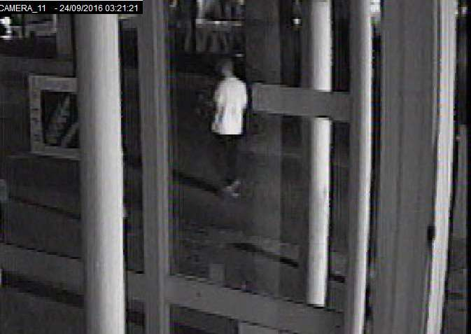A man in a white T-shirt and dark bottoms, with short hair, at 3.21am in Cornhill Walk. ANL-160812-110359001