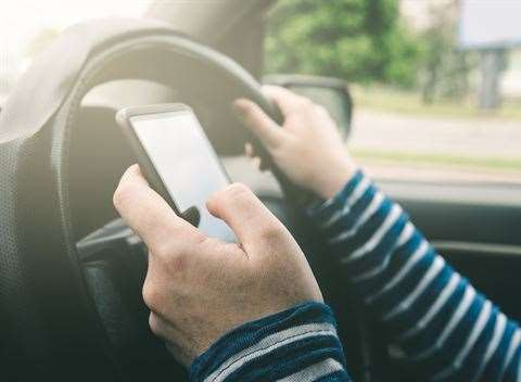 It's a criminal offence to use a mobile phone while driving (15244985)