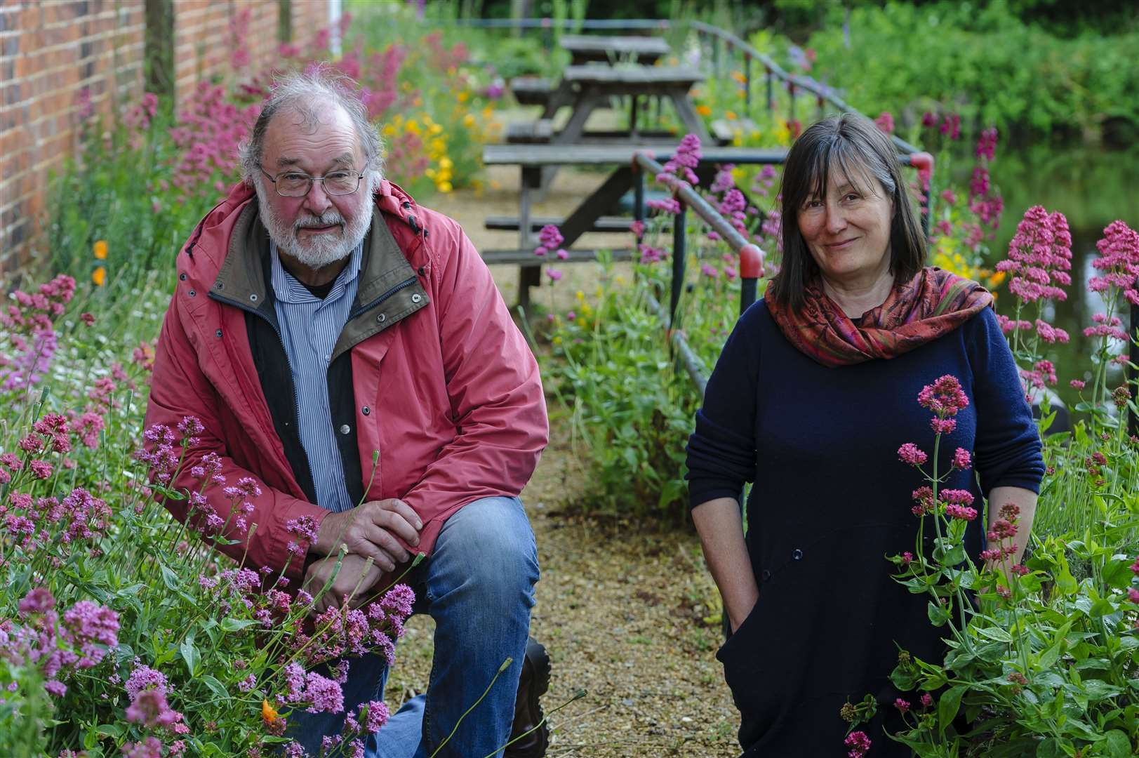 Volunteers have been sowing plants along the towpath behind the Quay Theatre in Sudbury, to improve the area for residents. Pictured are Denis Brogan, chairman of the board of trustees and Theresa Munson, theatre administrator...Picture: Mark Bullimore Photography. (11666712)