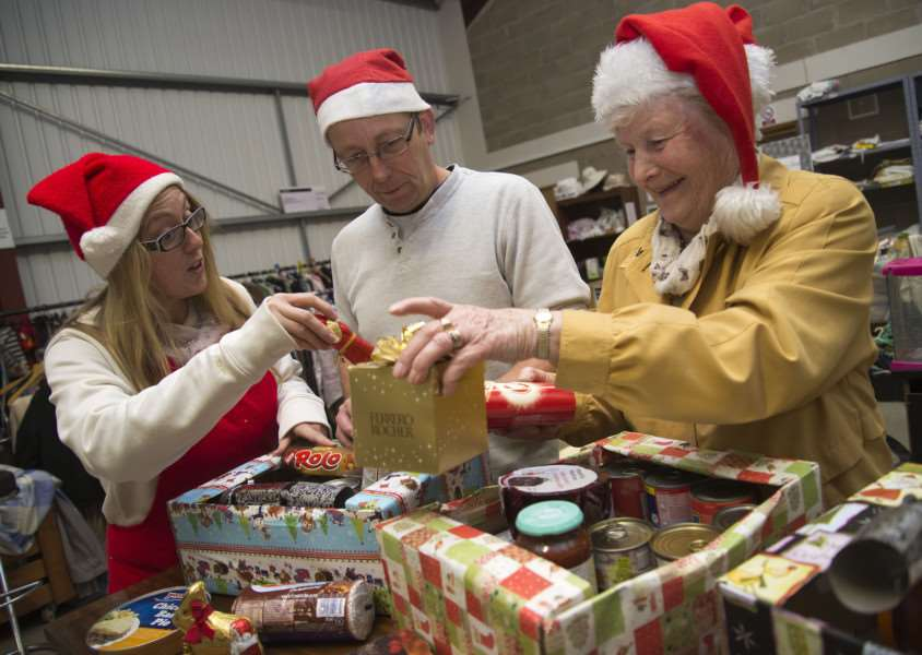 Gatehouse (community project), Dettingen Way Bury St Edmunds volunteers packing in the foodbank'Jo Gooch, Natasha Lux and Clive Williams'Picture Mark Westley ANL-150411-205914009