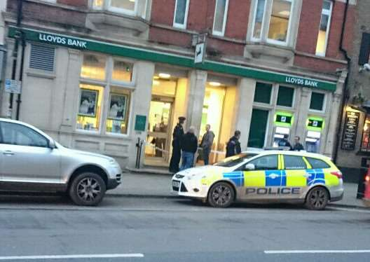 Police outside Lloyds Bank in Newmarket following the armed robbery ANL-151211-163148001