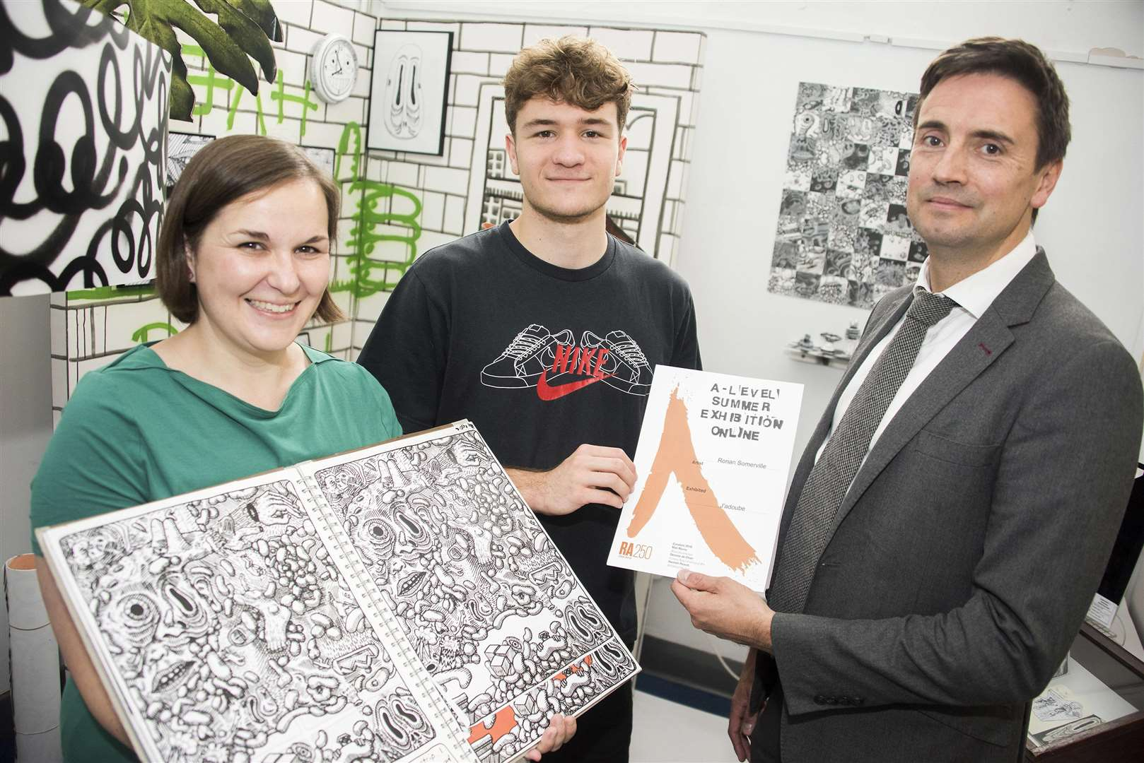Ronan Somerville (centre), with his certificate from the Royal Academy of Arts for entry to A-level summer exhibition with Gemma Gibson, (left) Head of Art Textiles and Photography at Thurston Sixth and Paul Potter (right) Vice Principal of Thurston Sixth. PICTURE: Mark Westley.